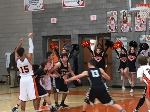 Kyle shooting from the free-throw line. Bulldog cheerleaders in background (click to enlarge photo).