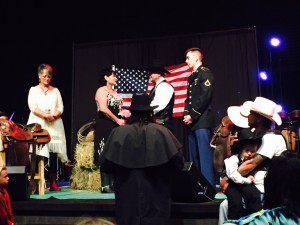 The ceremony, co-performed by Allen and Carlos (in long black coat), with Garland and Sylvianna in front of flag (click to enlarge, then back-arrow to return).