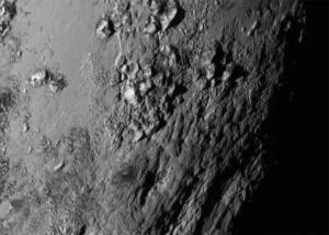 The first high-res image of Pluto's surface, revealing icy mountains (click to enlarge or to source).