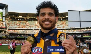 Superstar Cyril Rioli celebrates with his two medals (click to enlarge or to source, then back-arrow to return to blog).