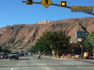 Main street of Moab, framed by towering red-rock cliffs (click to enlarge, then hit back-arrow to return to blog writeup).